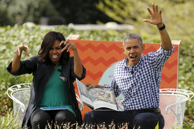 The Obamas act out scenes from the children's book 'Where the Wild Things Are' as they preside over the annual Easter Egg Roll at the White House in Washington